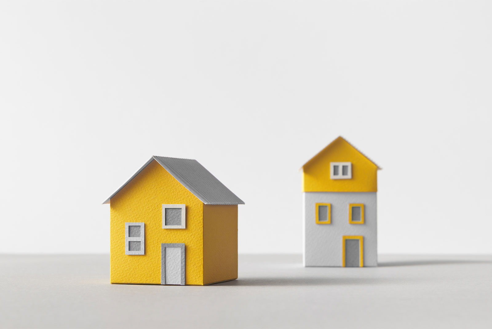 two houses looking at differences between HELOC and Home Equity Line of Credit