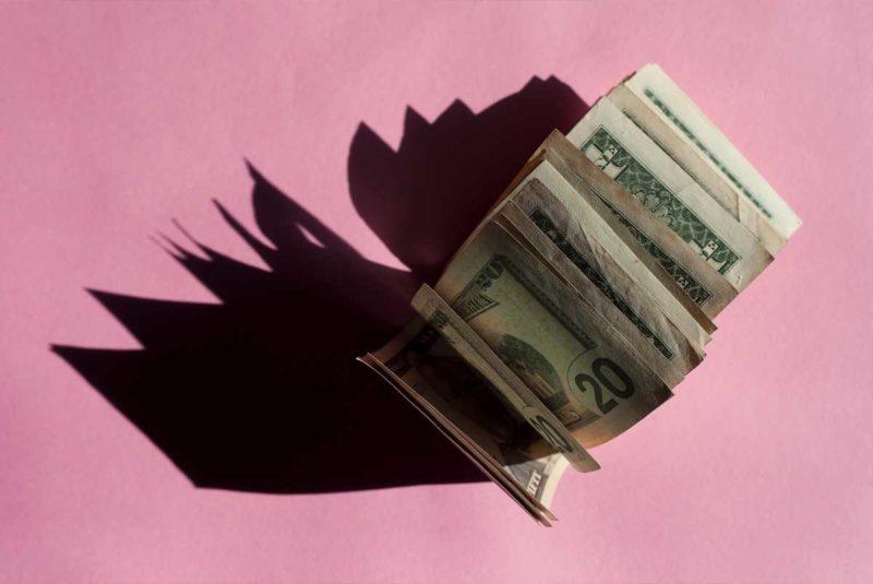 Cash on pink background