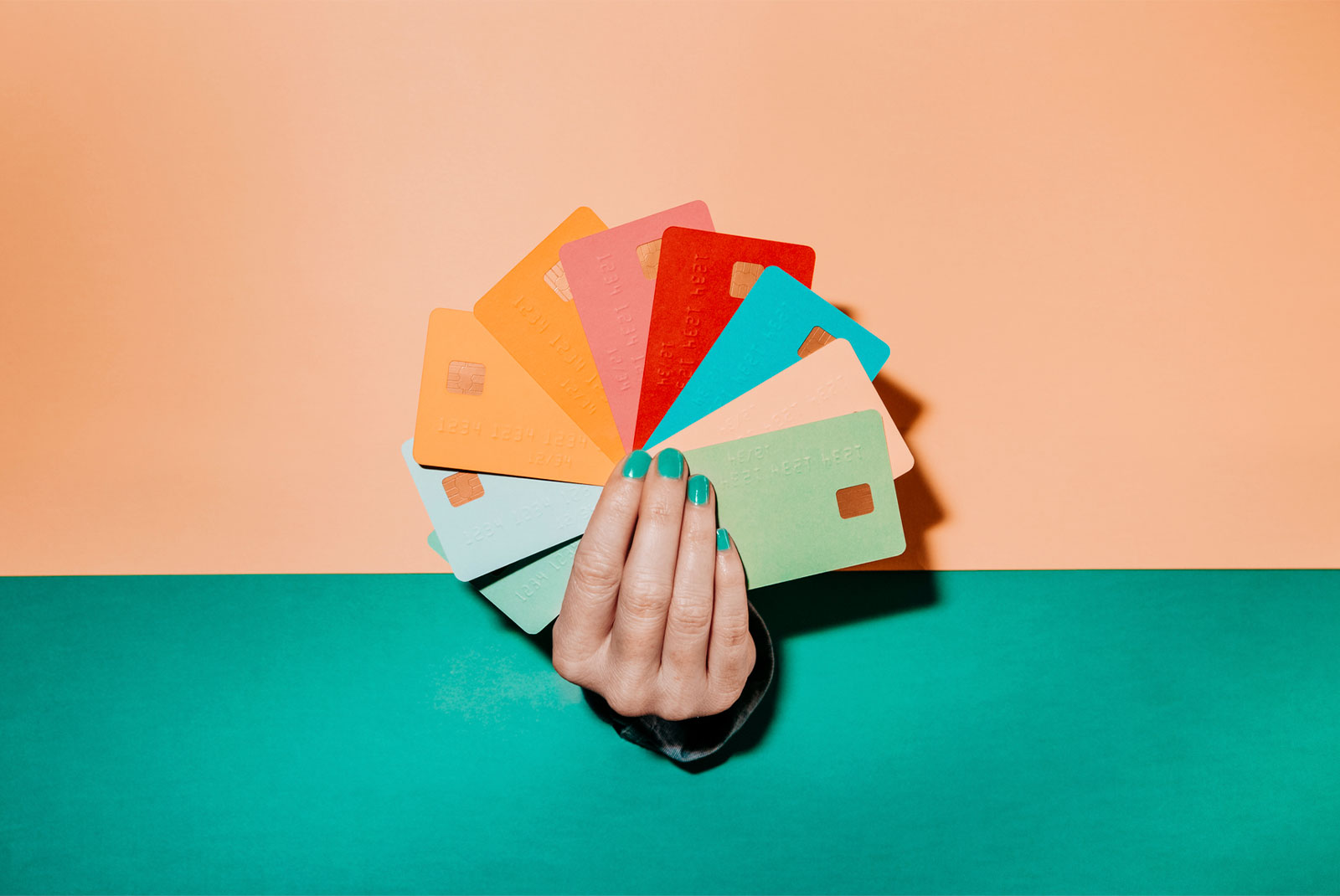 hand holding lots of credit cards for topic credit score to buy a house
