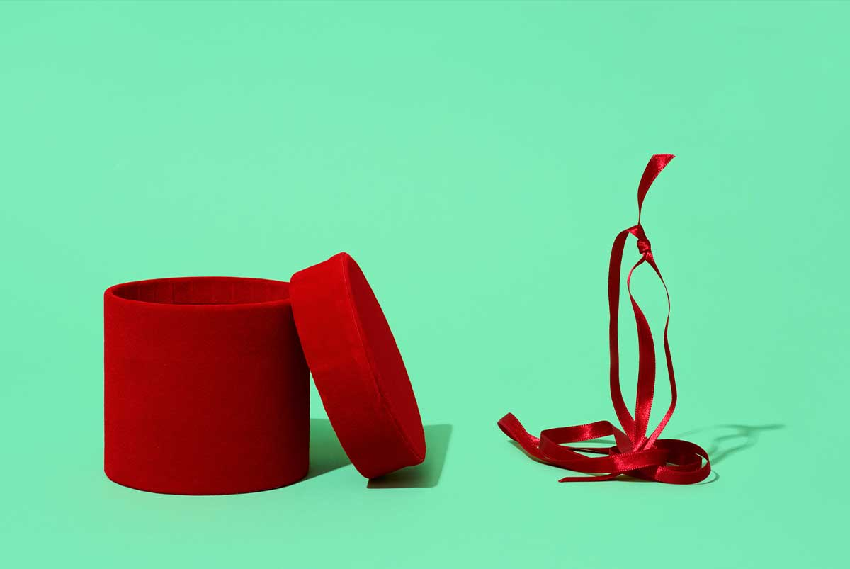 Red Gift Box on Green Background