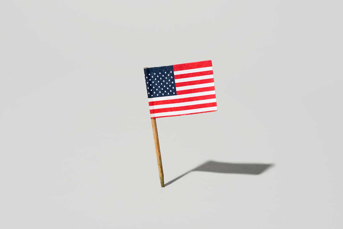 A small American flag tchotchke against a white background